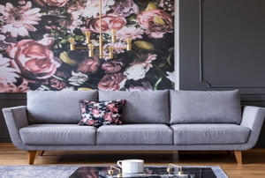 A living room decorated with bold floral wallpaper in a 2019 home design trend.