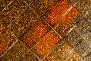 A close-up of some ornate, tin ceiling tiles.