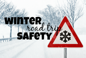 "A snowy road with the words ""winter road trip safety."""