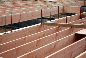 Floor joist foundation for a building