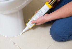 caulking the base of a toilet