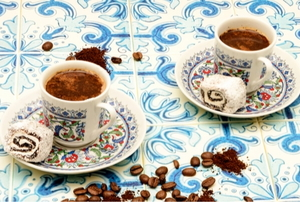Cups and saucers on a tiled surface