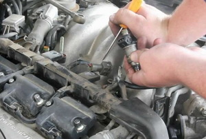 a person working on a car engine