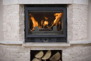 fireplace with beige brick hearth