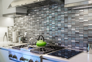 grey and white tile backsplash behind a stove