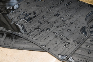 Rubber car mats with water droplets on them.