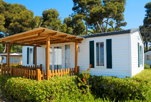 a mobile home with attached pergola