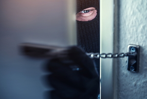 A burglar opening a locked door