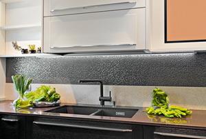 Modern kitchen with metallic look backsplash