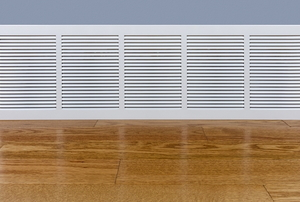 baseboard heater next to a wooden floor