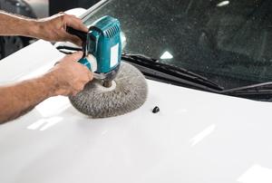 polishing car hood with tool