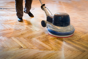 a parquet floor being waxed