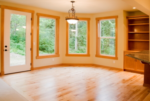 A breakfast room with a beautiful hardwood floor.