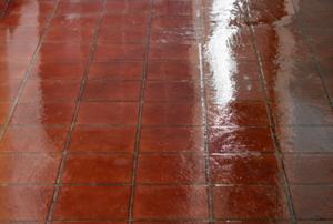 Reddish vinyl flooring with a bright shine.