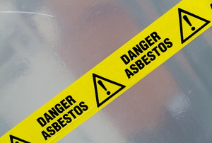 Caution tape warning of asbestos danger.