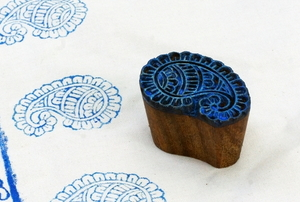 a blue stamp on a piece of fabric with a homemade pattern