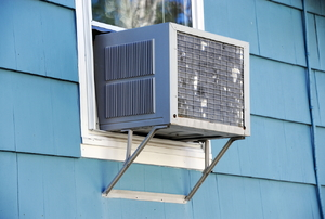 An air conditioner unit in a window.