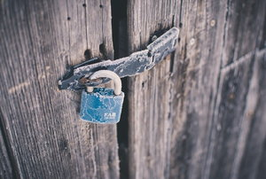Rustic wood shed with padlock on the door