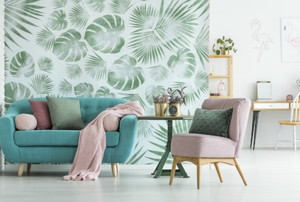 a bright living room with smashing green wallpaper and comfy furniture