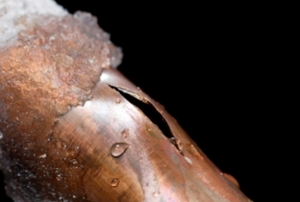 A frozen and cracked copper pipe.
