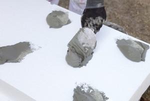 applying adhesive to foam board