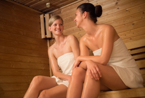 two women sitting in a sauna