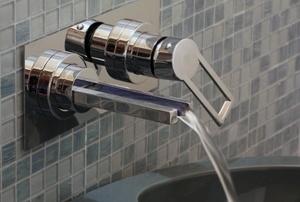 A wall mount bathroom faucet.