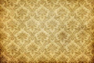 An old, damask wallpaper design.
