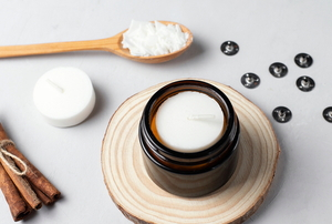 ingredients for making soy candles, including wax, cinnamon, and a wood spoon