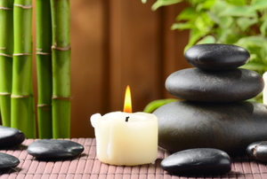 zen display with bamboo rocks and candles