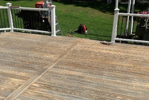 a gray deck in the process of restaining