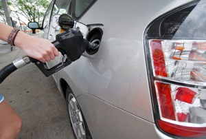 a person Filling the Tank of  a car
