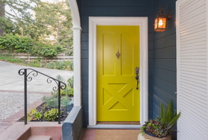 Yellow house door with white trim