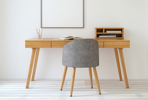 small simple desk in white room