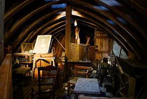 A dimly-lit attic full of antique junk.
