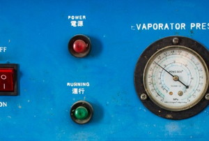 a blue evaporator with a switch, lights, and pressure meter