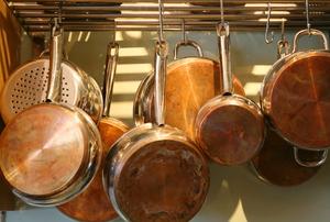 Copper pots hanging from a pot rack