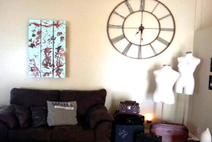A modern living room with a recycled pallet as wall art.