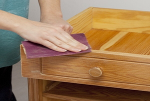 sanding a varnished side table