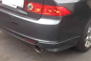 Tailpipe on a charcoal-colored car