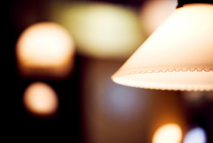 A close-up of a lamp with light in the background.