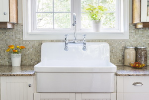 deep white kitchen sink with silver faucet
