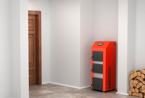 An orange and black indoor gas furnace.