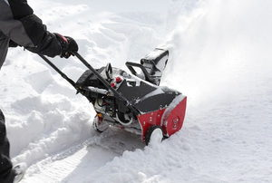 Man removing snow after storm with a snowblower