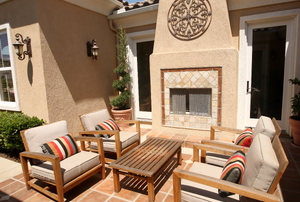 patio with furniture and brick fireplace