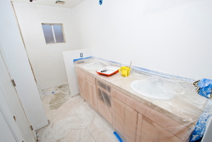Bathroom vanity covered in plastic during construction