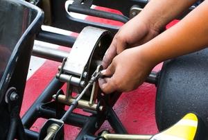 person working on go kart engine