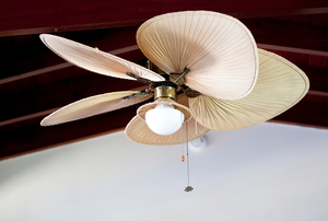 A tropical looking ceiling fan.