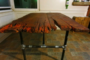 A reclaimed wood table made from a redwood horse corral.