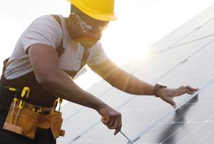 man installing solar panels in the sun